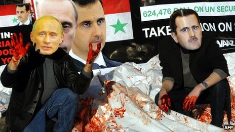 Avaaz activists wearing masks of Russian PM Vladimir Putin and Syrian President Bashar al-Assad dump bloodied body bags outside the UN&#039;s headquarters in New York (24 January 2012)