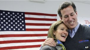 Republican presidential candidate, former Pennsylvania Sen. Rick Santorum hugs his wife, Karen during a stop at his campaign field office