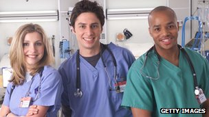 Sarah Chalke, Zach Braff, and Donald Faison in Scrubs