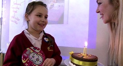 Hayley with birthday cake for leapling birthday girl
