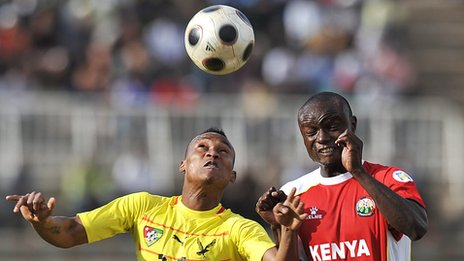 Togo's Segbefia Prince (yellow jersey) vies for possessio with Collins Okoth of Kenya