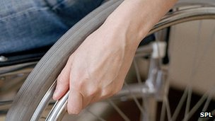 Man's hand on wheelchair