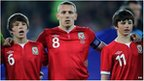 Craig Bellamy (centre) with Gary Speed&#039;s sons Ed and Tom during the International Friendly at Cardiff City Stadium, Cardiff