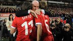 Gary Speed's father Roger hugs his grandsons Ed and Tommy before kick-off