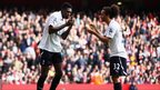Emmanuel Adebayor (left) of Tottenham Hotspur celebrates his penalty with Benoit Assou-Ekotto
