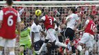 Arsenal's French Bacary Sagna (centre) scores against Tottenham Hotspur