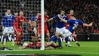 Cardiff City's Ben Turner (second right) shoots to score against Liverpool