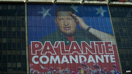 "Giant photograph of Hugo Chavez on the facade of the state oil company PDVSA, reading ""Onward, commander"" - 29 February"