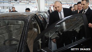 Bulgarian Prime Minister Boyko Borisov inspects a car at the GWM plant in Bahovitsa