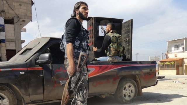 An activist in the Syrian city of Homs has said the Free Syrian Army has left the embattled district of Baba Amr