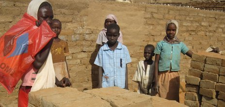 Brick makers in Abu Shouk camp in Darfur, Sudan