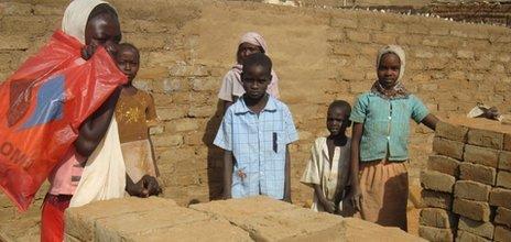 Brick makers in Abu Shouk camp in Darfur, Sudan