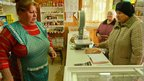 Shopkeeper Anna Vassilievna Romanova (left) with customers. Photo: Dmitry Berkut