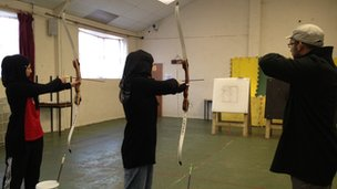 Pupils being coached in archery target practice