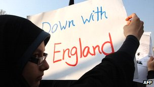 "A protester holds a placard saying ""Down with England"" during anti-UK protests in Tehran in November 2011"