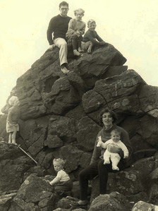 Mark and his father atop a rock in Arran with family friends