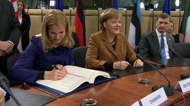 EU leaders sign new debt treaty.