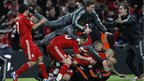 Liverpool&#039;s players react after winning on penalties against Cardiff City during their English League Cup final football match at Wembley Stadium 