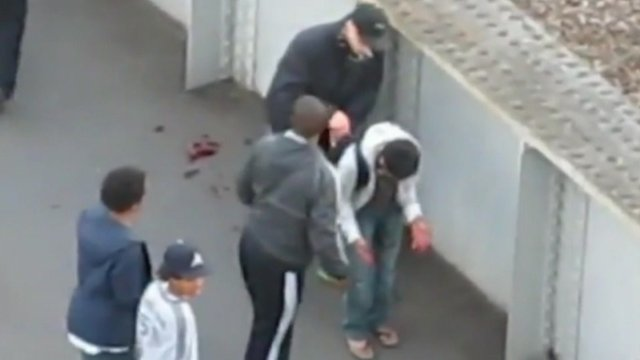 Two men caught on camera in east London robbing an injured student.