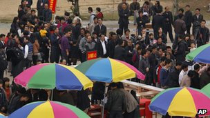Villagers queue up at a polling station in Wukan