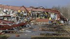 An employee of Henryville High School examines the remains of the building following severe storms 2 March 2012