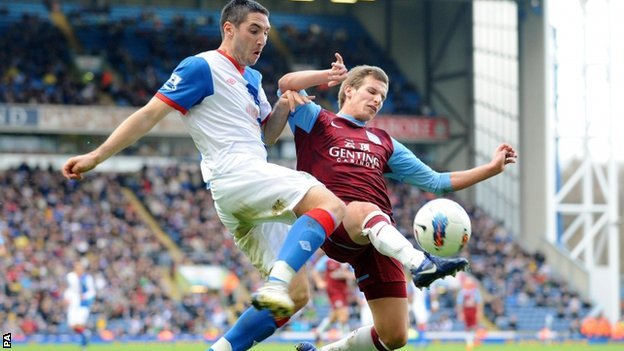 Blackburn's Bradley Orr is tackled by Aston Villa's Marc Albrighton