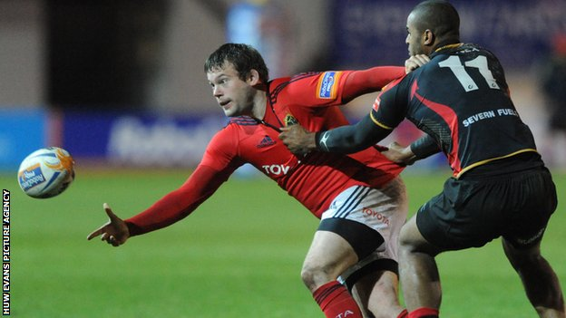 Munster's Denis Fogarty is tackled by Aled Brew