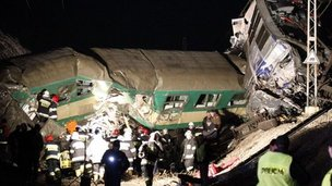 Rescuers work late on 3 March 3 at the scene where two trains crashed head-on in Szczekociny, southern Poland