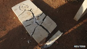 A headstone broken at the Benghazi War Cemetery and the Benghazi British Military Cemetery