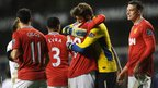 Manchester United players celebrate after beating Spurs