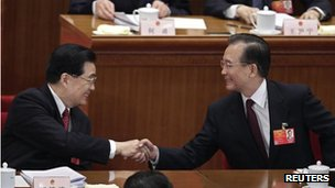 "China's Premier Wen Jiabao, right, shakes hands with President Hu Jintao after the opening ceremony of the National People""s Congress (NPC) at the Great Hall of the People in Beijing 5 March, 2012"