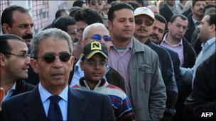 Amr Moussa in long line of men outside a polling station in Heliopolis on 28 November 2011