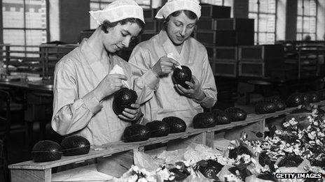 Two women at Cadbury&#039;s chocolate factory in Bournville, in the West Midlands join together chocolate Easter egg halves in 1932. Photo: Getty Images