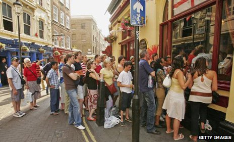 Fans crowd around a pub to watch an England match