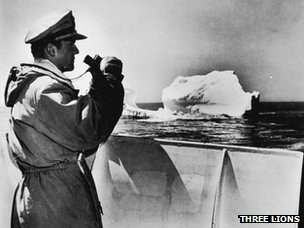 A member of the International Ice Patrol monitors an iceberg