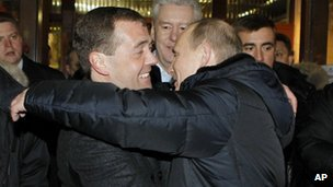 Russian President Dmitry Medvedev, left, and Prime Minister Vladimir Putin 04 March 2012