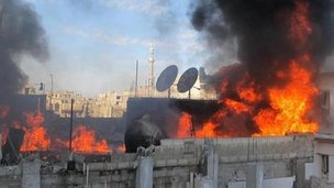 A building on fire in Baba Amr in Homs