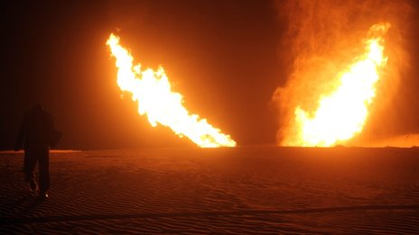 Two jets of flame apparently rise from the desert, 5 March 2012