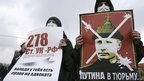 Participants hold placards during a protest demanding fair elections in the south Russian city of Rostov-on-Don