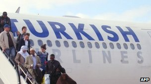 People disembarking from a Turkish Airlines flight on 6 March 2012 in Mogadishu, Somalia's capital