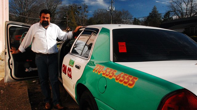 Jose Luis Diaz and his cab