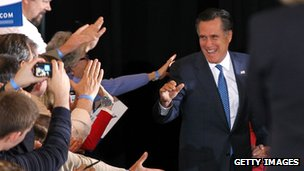 Mitt Romney approaches the stage to deliver his victory speech after wins in Vermont, Virginia and Massachusetts on Super Tuesday 6 March 2012