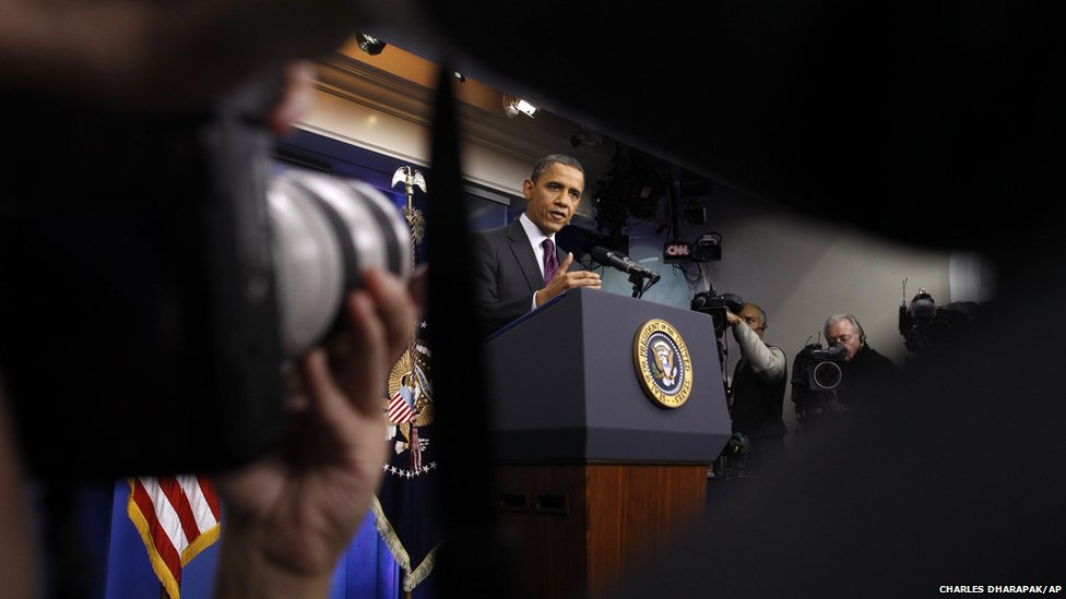 President Barack Obama gestures during a news conference