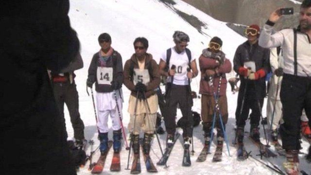Skiers line up on the slopes of Bamiyan