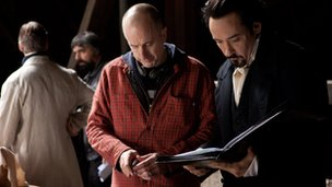 Director James McTeigue with John Cusack on the set of The Raven