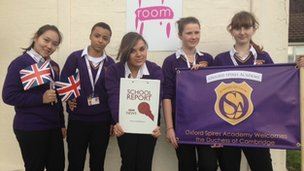 School Reporters at Oxford Spires Academy wave their banners and Flags in preparation for the duchess' visit