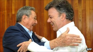 Colombian President Juan Manuel Santos embracing his Cuban counterpart Raul Castro