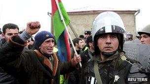 A protester shouts at riot police in Quba, Azerbaijan 1 March