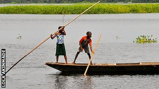 Schoolchildren paddle a canoe near Lagos