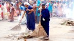 Janitors at work as devotees begin to disperse